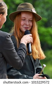 Karlovy Vary, Doupov / Czech republic - 06/01/2016: interview with a ginger haired girl at the horn player's contest