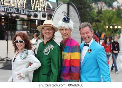 KARLOVY VARY - JULY 2: Dorigen Hammond, director Jes Benstock, actor Andrew Logan and Michael Davis (L-R) arrives at the International Film Festival, Karlovy Vary on July 2, 2011, Czech Republic