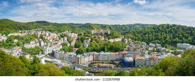 Karlovy Vary town with cloudy blue sky panoramic view taken from hill near the town, Karlovy Vary, Czech Republic, May 2nd 2018