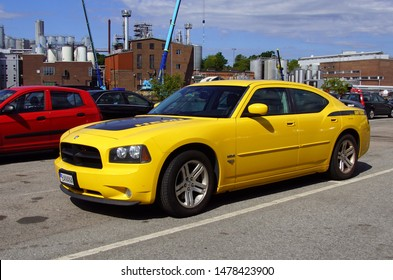 Karlshamn, Sweden - July 26, 2019: Yellow Dodge Charger Hemi Daytona parked on a public parking lot. Nobody in the vehicle.