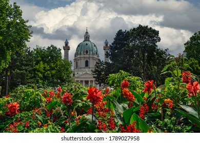 Karlskirche Vienna, baroque church and travel destination with flowers in front