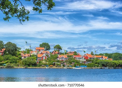 KARLSKRONA, SWEDEN - 2017 July. Typical red Swedish wooden houses with natiaonal flag in the city of Karlskrona.