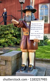Karlskrona, Sweden - 24,05,2016 : In front of the Karlskrona Admiralty Church the wooden figure Rosenbom collects money for the poor. A money box is located under his hat.