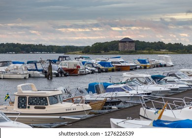 Karlskrona, Sweden- 31 August, 2014: Sailboats and boats moored in the port. Island with campsite in the background.