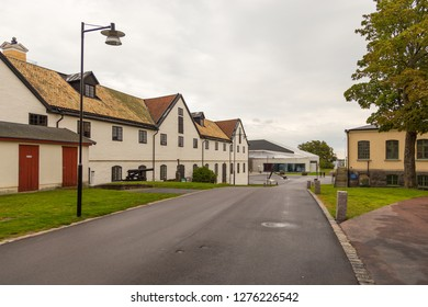 Karlskrona, Sweden - 31 August, 2014: Old building in Karlskrona. Empty, wet street in the center of town.