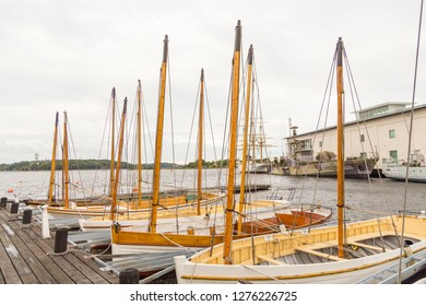 Karlskrona, Sweden - 31 August, 2014: Sailboats moored in the port. Warships, sailing ship and building Marinmuseum in the background.