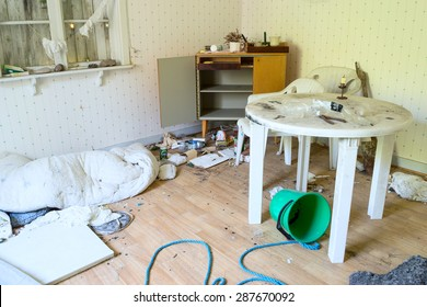 KARLSKRONA, SWEDEN - JUNE 15, 2015: The interior of an abandoned house with lots of debris. Places like this often become temporary homes for homeless people.