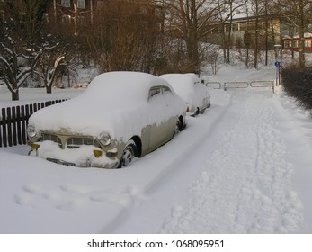 Karlskrona / Sweden - March 2005: Cars covered in snow on a street in town