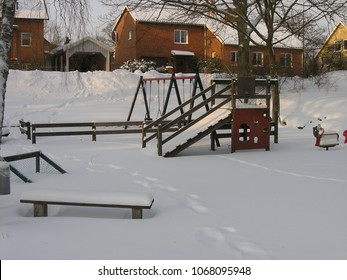 Karlskrona / Sweden - March 2005: A childrens play area covered in snow