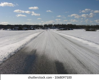 Karlskrona / Sweden - March 2005: A country road where snow has drifted across