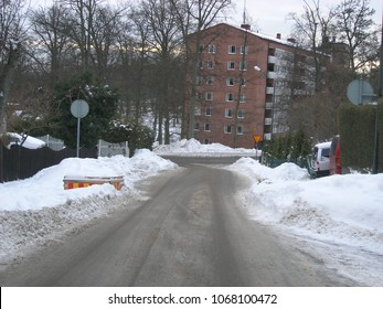 Karlskrona / Sweden - March 2005: Snow piled up along the roads after the snow plough has cleared them