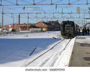 Karlskrona / Sweden - March 2005: A train waiting on the platform at the station in the snow
