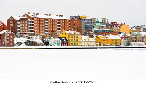 Karlskrona, Sweden - March 4, 2018: Documentary of everyday life and environment. Borgmastarekajen on Trosso island on a wintry day seen from the sea.