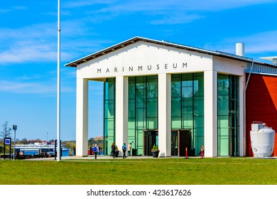 Karlskrona, Sweden - May 3, 2016: The entrance to the Marinmuseum (maritime museum) at Stumholmen island. People walk by outside.