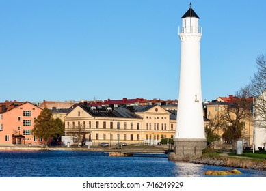 Karlskrona, Sweden - October 30, 2017: Environmental documentary. The lower lighthouse at Stumholmen island with the city in the background.
