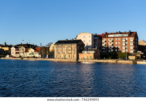 Karlskrona, Sweden - October 30, 2017: Environmental documentary. Part of the city seen from the sea. The Hollstromska warehouse historic building in center.