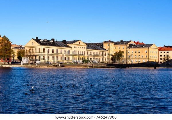 Karlskrona, Sweden - October 30, 2017: Environmental documentary. The old Sparre battalion buildings seen from the sea, now World heritage site and used as school and business.