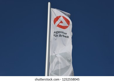 Karlsruhe Baden-Wurttemberg / Germany - May 18, 2018: Flag with the Logo of a Job Center - Agentur für Arbeit, the state owned employment agency in Karlsruhe, Germany
