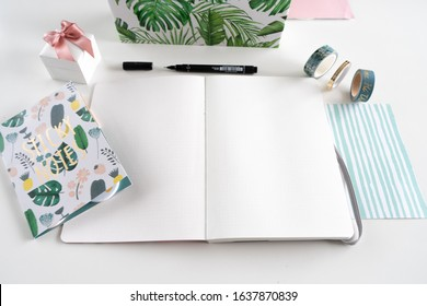 Karlsruhe, Germany - 02.02.2020: bullet journal - close up of journal with notebook, pen, decorative tape, sticky notes and camera
