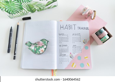Karlsruhe, Germany - 02.02.2020: bullet journal - close up of habit tracker decorated with washi tape, a jewelry box and jungle patterned directory