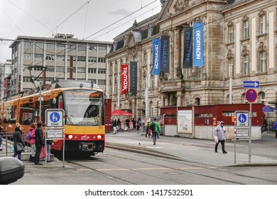 Karlsruhe, Germany - 09 February 2019: The image shows a part of city of Karlsruhe with a yellow train in front of the Postgalerie.