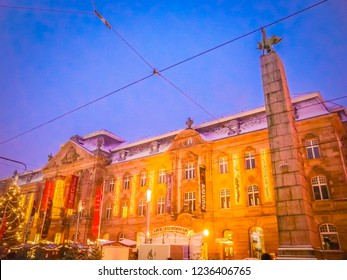 Karlsruhe, Baden-Württemberg / Germany - 12 23 2009: Post Galerie on a snowy day in winter at dusk at Karlstrasse Street in Karlsruhe in the Schwarzwald or Black Forest in the southwest of Germany