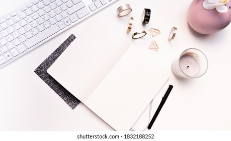 Karlsruhe, Germany - 12.10.2020: mockup of office arrangement with notebook, keyboard and washi tapes and candle