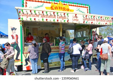 """Karlsruhe, Germany - April 2013: Mobile outdoor food stand with traditional Hungarian food called """"Lángos"""" at  fairground during big anual flea market"""