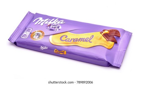 Karlsruhe, Germany - April 28: 2017. Milka chocolate, Caramel version, studio isolated on white. Milka is manufactured by the US confectionery company MondelÄ?z International since 1990