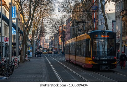 Karlsruhe, Germany - January 2017: View of the central street in the historical old district of Karlsruhe with the modern tramway car by a winter afternoon