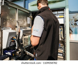 KARLSRUHE, GERMANY - MAY 11, 2018: Close-up of male operator repairing the train ticket fahrkarte service vending machine located near the entrance of the Karlsruhe Airport