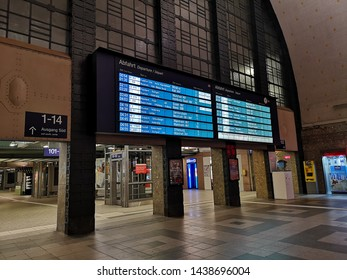 Karlsruhe,Germany - April 12, 2019:  Timetable & Train departures status for passengers at Departures Hall at Karlsruhe Hauptbahnhof for passengers