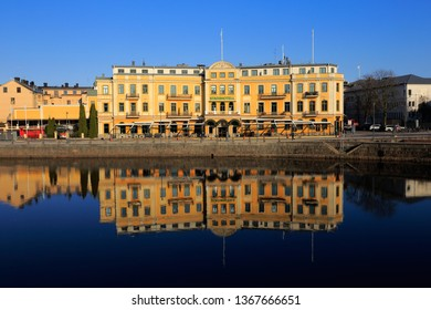 Karlstad, Sweden - April 11, 2019: Exterior view of the Elite Karlstad Stadshotell hotel with its reflection in river Klaralven.