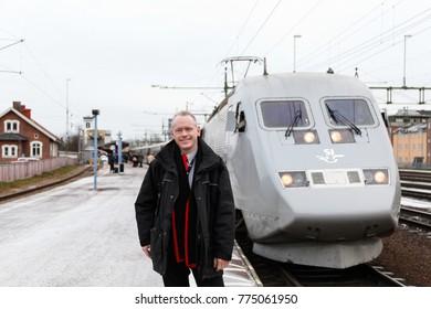 KARLSTAD, SWEDEN - DECEMBER 6, 2017: SJ train driver at Karlstad station in Sweden