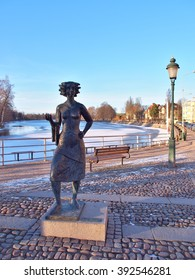 KARLSTAD, SWEDEN - FEBRUARY 25, 2016: Statue of Eva Lisa Holtzat, a Swedish waitress and innkeeper who became the symbol for the Karlstad city. She was known in Sola i Karlstad (the Sun in Karlstad).