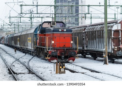 KARLSTAD, SWEDEN - JANUARY 13, 2010: Diesel locomotive with cargo train at the central station in Karlstad, Sweden