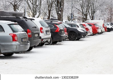 Karlstad, Sweden - January 31, 2019: A row of parked cars in the downtown district.