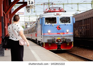 Karlstad, Sweden - July 13, 2019: Passenger train with a class Rc3 electric locomotive in service for the operator Tagab arriving Karlstad Central station.