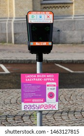 Karlstad, Sweden - July 13, 2019: Electric car public charging station payable with the Easypark app.