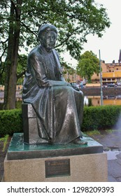 Karlstad, Sweden - July 29, 2015: Bronze Statue of the famous writer Selma Lagerlof, who was born not far from Karlstad, in Marbacka. Sculptor: Arvid Backlund. Erected in 1958. Scandinavia, Europe.