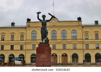 Karlstad, Sweden - July 29, 2015: Peace monument in front of the town hall on the Great Square. Erected in 1955 to commemorate the peaceful dissolution of the union between Sweden and Norway in 1905.