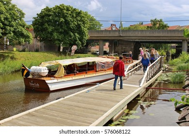 Karlstad, Sweden - July 30, 2015: People get on a waterbus in Karlstad, Sweden, Europe. The boats or waterbuses drive on the river, canals and bay of the town and cost as low as normal buses.