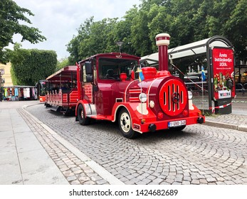 Karlstad, Sweden - June 14, 2019: A red Dotto train in the city center on sightseeing tour.