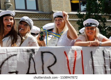Karlstad, Sweden - June 8, 2018: Close up of Swedish happy students wearing traditional student caps celebrating their degree by riding a flatbed truck through the city streets.