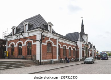 KARLSTAD, SWEDEN - MAY 1, 2019: Car and bus outside the central station in Karlstad, Sweden