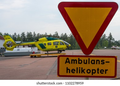 KARLSTAD / SWEDEN - May 2018 Svensk Luftambulans Airbus Helicopters H145 (EC 145 T2), SE-JXA, cn 20050 awaiting the next mission. Focussed on warning sign and Heli.