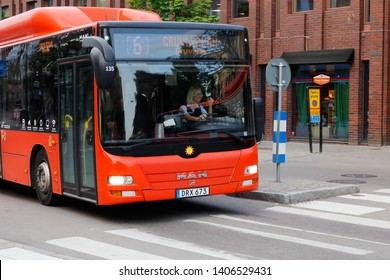Karlstad, Sweden - May 21, 2019: Front view of an orange city bus in service on line 6 operated by the public transportation comnpany Karlstadsbuss.