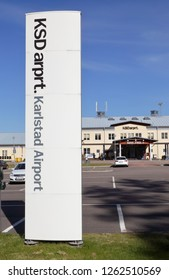 Karlstad, Sweden - May 26, 2016: Karlstad airport sign in the foreground with the terminal building in the background.,