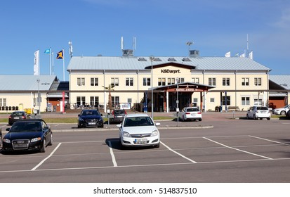 Karlstad, Sweden - May 26, 2016: Parking with parked cars in front of Karlstad airport terminal building.