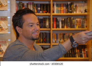 KARLSTAD, SWEDEN - NOV 20: Andreas Carlsson from the Swedish Idol 2010 Jury signs copies of his new book Dandy at the book store Akademibokhandeln on November 20, 2010 in Karlstad, Sweden